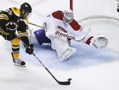 Boston's Chris Kelly put the Bruins ahead 3-2 in the third period, but Montreal tied it to force overtime.