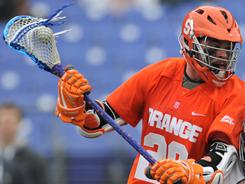 Syracuse senior attackman Stephen Keogh, left, enters the showdown with unbeaten Notre Dame leading the Orange in goals (26) and points (33).