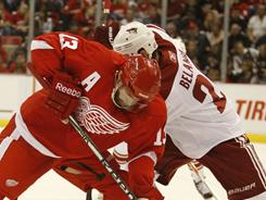 Detroit's Pavel Datsyuk, winning a faceoff from Phoenix's Eric Belanger, is in the running for a fourth consecutive Selke Trophy