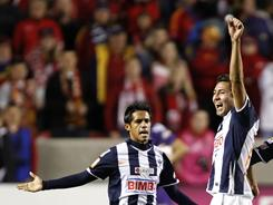 Monterrey's Severo Meza, left, and Abraham Carreno celebrate their 1-0 win over MLS' Real Salt Lake at the CONCACAF Championship game in Sandy, Utah.