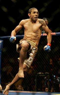 Jose Aldo, celebrating after beating Cub Swanson in June 2009, was the last featherweight champ in World Extreme Cagefighting and the first in the Ultimate Fighting Championship.