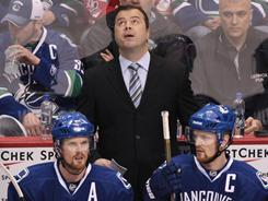 Coach Alain Vigneault led the Vancouver Canucks to a franchise-best 117-point season.
