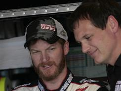 Dale Earnhardt Jr. (left) talks with crew chief Steve Letarte during Sprint Cup practice at Richmond International Raceway. Earnhardt is ranked third in points and has five top 10s in his first eight races with Letarte leading the No. 88 Chevrolet team.