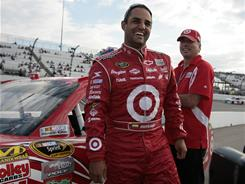 Juan Pablo Montoya smiles after turning the fastest lasp Friday during NASCAR Sprint Cup qualifying at Richmond International Raceway.