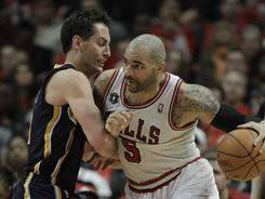 Chicago Bulls forward' Carlos Boozer, right, drives to the basket vs. Indiana Pacers forward Jeff Foster during their first-round playoff series won in five games by the Bulls.