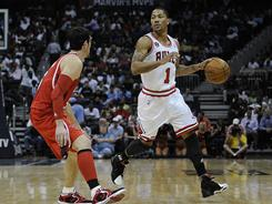 Chicago Bulls point guard Derrick Rose (1) dribbles against Atlanta Hawks guard Kirk Hinrich (6) during a game March 22.