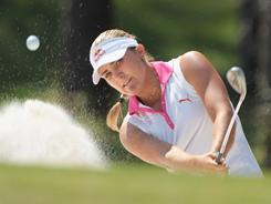 Alexis Thompson fires a shot out of a bunker shot on the 16th hole during the third round of the Avnet LPGA Classic on Saturday in Mobile, Ala.