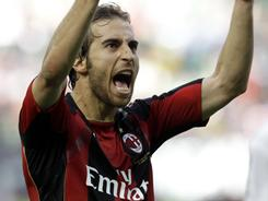 Mathieu Flamini celebrates AC Milan's 1-0 win over Bologna, moving a point away from another Serie A title. Flamini's eighth-minute goal was the difference in the match.