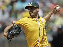 Gio Gonzalez kept the heavy-hitting Rangers at bay as the A's won easily 7-2 over their AL West rivals.