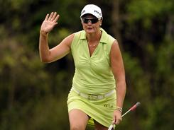 Maria Hjorth acknowledges the cheers after blasting out of the bunker onto the eighth green during the final round of the Avnet LPGA Classic on Sunday in Mobile, Ala.