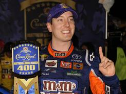 Kyle Busch celebrates another win for Joe Gibbs Racing at Richmond International Raceway.