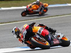 Dani Pedrosa steers his Honda ahead Casey Stoner on his way to winning the Portugal motorcycling Grand Prix.
