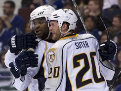 Ryan Suter, celebrating with Joel Ward, scored the tying goal and had an assist on Matt Halischuk's game-winner.