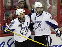 Marty St. Louis, left, is crucial to the Lightning's hopes, but less-heralded Teddy Purcell is also important.