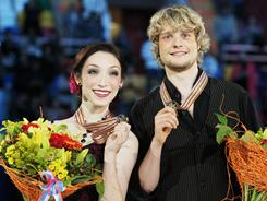 Ice dancers Meryl Davis and Charlie White after winning gold medals at the ISU world figure skating championships in Moscow,