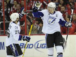 Vincent Lecavalier, right, and Martin St. Louis turned into the Lightning's dynamic duo this postseason, accounting for a combined nine goals and 11 assists.