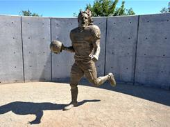 A statue of former Arizona Cardinals and Arizona State Sun Devils linebacker Pat Tillman stands at the University of Phoenix Stadiium. Tillman gave up his football career to join the military after the Sept. 11 attacks. He died in Afghanistan.