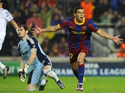 Barcelona's Pedro Rodriguez celebrates after scoring past Real Madrid goalkeeper Iker Casillas in the second half.