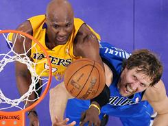 Los Angeles Lakers forward Lamar Odom, left, and Dallas Mavericks forward Dirk Nowitzki of Germany battle for a rebound during the second half of the Mavs' Game 1 victory Monday in a Western Conference semifinal series.