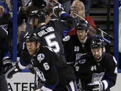Ryan Malone (6) celebrates scoring what proved to be the game-winning goal with his teammates in the third period of the Lightning's 4-3 win against the Capitals on Tuesday.