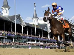 John Velazquez rides Uncle Mo to victory during the Juvenile race at the Breeder's Cup at Churchill Downs last November. Will Uncle Mo make the Kentucky Derby field on Saturday, also at Churchill Downs?