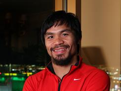Manny Pacquiao, posing in his suite at Mandalay Bay in Las Vegas,