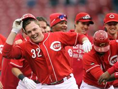 Jay Bruce celebrates with teammates after driving in the winning run in the Reds 3-2 victory over the Astros.