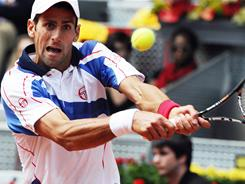 Novak Djokovic of Serbia lines up a backhand during his victory Wednesday against Kevin Anderson of South Africa at the Madrid Open.