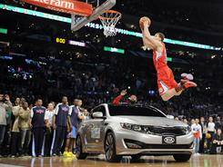 Los Angeles Clippers Blake Griffin does the iconic dunk over a car, with Baron Davis feeding him the ball from inside, to win the Slam Dunk Contest at the NBA's All-Star weekend in February. Griffin unanimously was named NBA Rookie of the Year on Wednesday.