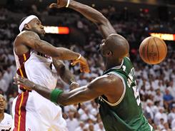 Heat forward LeBron James, left, swatting the ball away from Celtics forward Kevin Garnett, has three blocks and three steals in the first two games of the series.