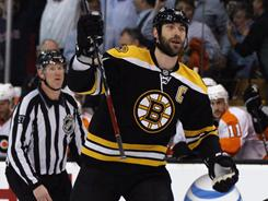 Zdeno Chara celebrates teammate David Krejci's goal early in the Bruins' 5-1 Game 3 win vs. the Flyers. Chara had a two goals, an assist and a plus-5 rating in Boston's win.