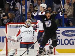 Steve Downie (9) celebrates a third-period goal by Marc-Andre Bergeron, not pictured, during the Lightning's 5-3 win against the Capitals on Wednesday. Tampa Bay swept the series.