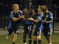 Earthquakes teammates mob the shirtless Ike Opara after his extra-time goal against the Timbers.