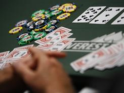 Cards and chips are on the table on opening day of last summer's World Series of Poker in Las Vegas.