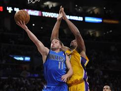 Dallas Mavericks point guard Jose Juan Barea (11) flies to the hoop past the Lakers Andrew Bynum during second half action of Dallas' Game 2 win Wednesday in their Western Conference semifinal series at Los Angeles.