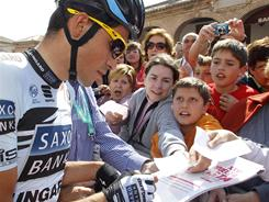 Saxo Bank rider Alberto Contador of Spain signs autographs before the last stage of the Vuelta de Castilla y Leon cycling race on April 17.