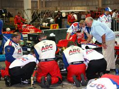 A.J. Foyt, right, looks on as the ABC Supply crew repairs Vitor Meira's car during a long rain delay in Brazil. Meira hit the wall after his brakes locked up, but he still managed a 17th-place finish.