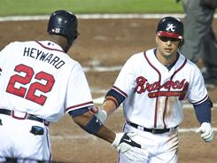 Martin Prado trots off the field after his go-ahead home run in the eigth earned the Braves a four-game sweep of the Brewers.