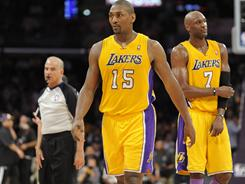 Los Angeles Lakers forward Ron Artest, center, walks off the court after being ejected in the second half of the Game 2 loss Wednesday to the Dallas Mavericks after clotheslining guard J.J. Barea.