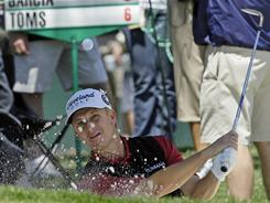 David Toms hits from a bunker on the 16th hole on his way to a first-round 6-under 66 on Thursday in the Wells Fargo Championship golf tournament at Quail Hollow Club in Charlotte.