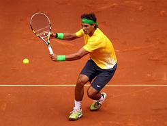 Rafael Nadal, playijng a backhand during his quarterfinal match, cruised past Michael Llodra to reach the Madrid Open semifinals.