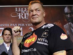 Brian Nielsen pulled down his shorts Friday, exposing his bare backside to the audience at the official weigh-in with Evander Holyfield