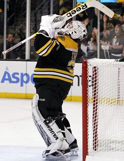 Boston goalie Tim Thomas celebrates after the Bruins defeated the Philadelphia Flyers 5-1 in Game 4 in their second-round playoff series in Boston.