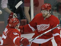 Detroit Red Wings center Darren Helm (43) celebrates with defenseman Niklas Kronwall after scoring a goal in the third period.