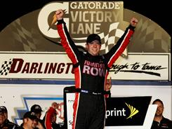 Regan Smith celebrates at Darlington Raceway after capturing the Showtime Southern 500, his first NASCAR Sprint Cup victory in 105 starts.
