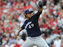 Yovani Gallardo (49) allowed just one hit in eight innings in the Brewers 4-0 win over the Cardinals on Saturday. Gallardo had a no-hitter through seven innings .