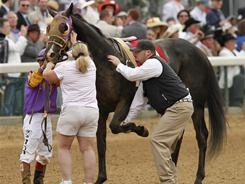 Archarcharch was taken away to be treated for a left leg fracture after the 137th Kentucky Derby horse race at Churchill Downs.
