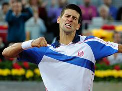Novak Djokovic pumps his fist in celebration during his three-set victory Saturday against Thomaz Belluci of Brazil in the semifinals of the Madrid Open. Djokovic rallied from a set down to stay unbeaten in 2011.