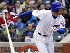 Kosuke Fukudome, seen here doubling in the fifth inning, hit a game-winning single in the bottom of the ninth inning to give the Cubs a 3-2 win over the Reds on Saturday.
