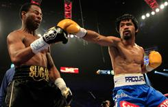 Manny Pacquiao, right, throws a punch at Shane Mosley in their WBO welterweight title fight in Las Vegas.